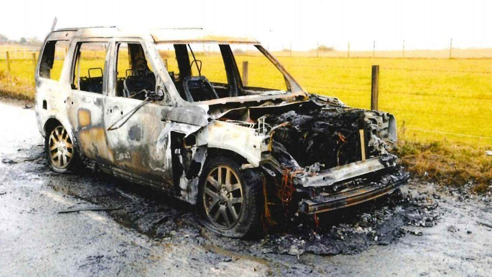 Burnt-out Landrover Discovery