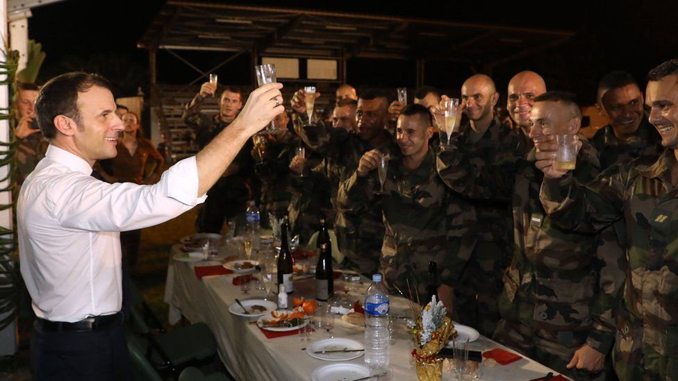 French President Emmanuel Macron has Christmas dinner with French troops at the Port-Bouet military camp near Abidjan, Ivory Coast, on 21 December, 2019.
