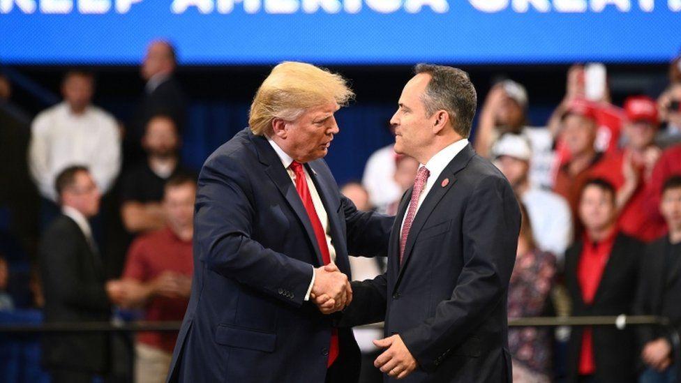Donald Trump shakes hands with Kentucky governor Matt Bevin during a rally in Lexington, Kentucky