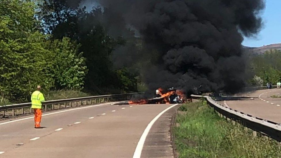 Plane in flames on the road