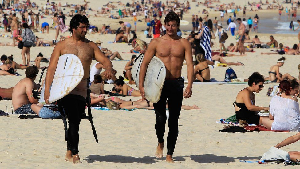 Australian surfers on beach