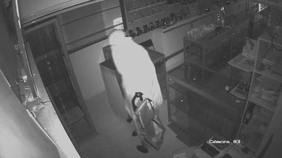 CCTV of man in burka