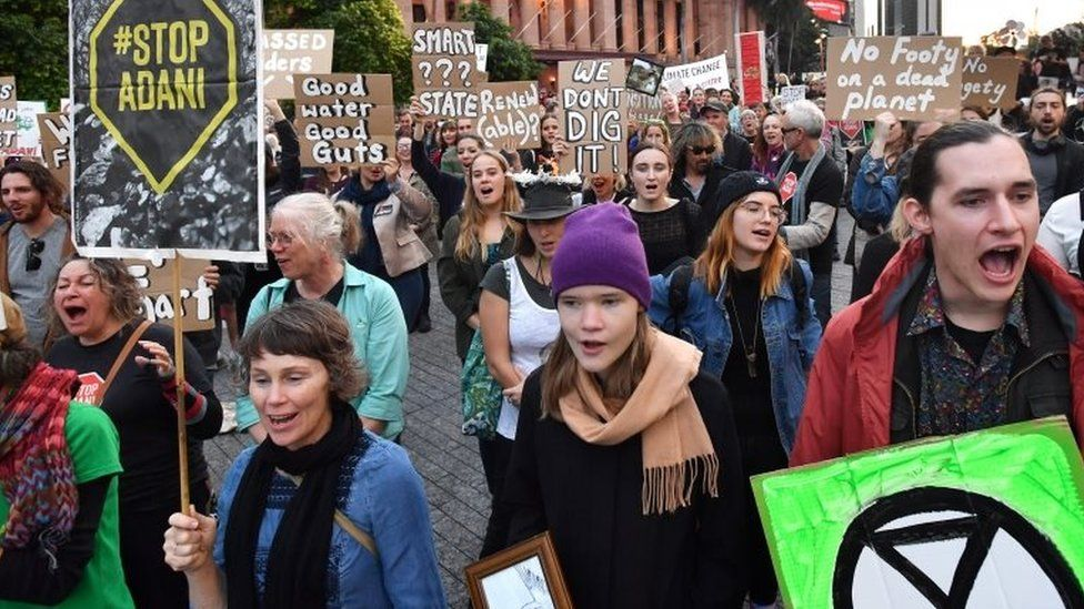 People protest against the Adani mine in Australia