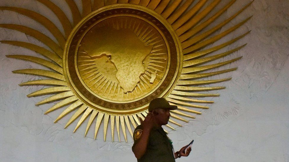 A security personnel stands by a sculpture representing the African continent, before the start of the 30th Ordinary Session of the Assembly of Heads of State and Government of the African Union (AU), in the entrance hall of the AU headquarters in Addis Ababa on January 27, 2018