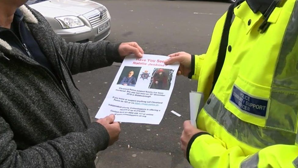 Police handing out leaflets