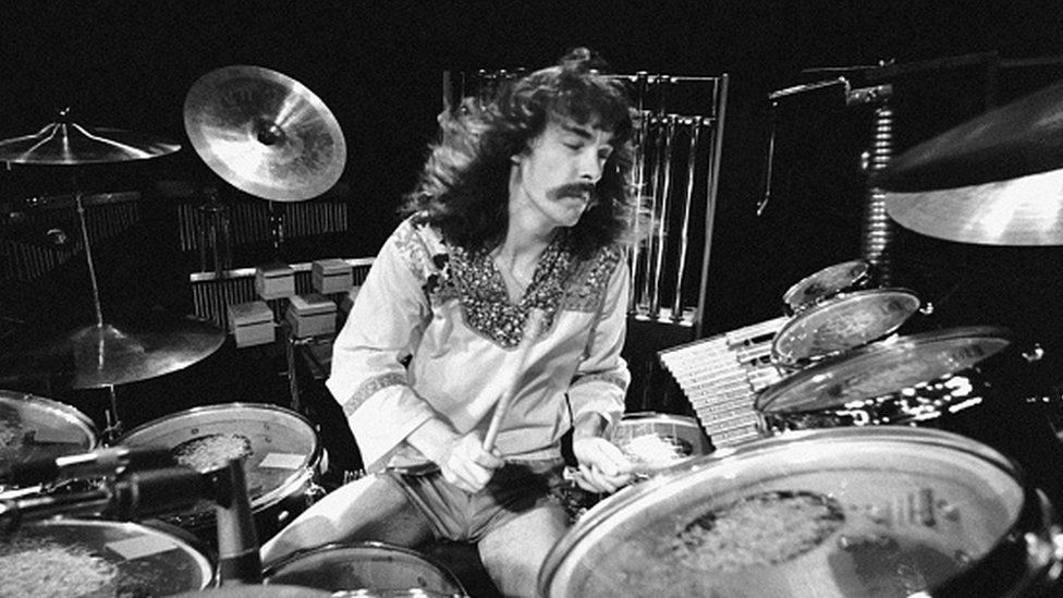 Neil Peart performing live onstage, playing drums at the Odeon on A Farewell To Kings Tour
