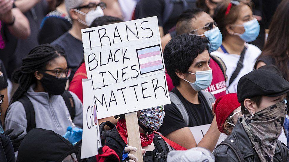 Black trans lives matter banner at George Floyd protest
