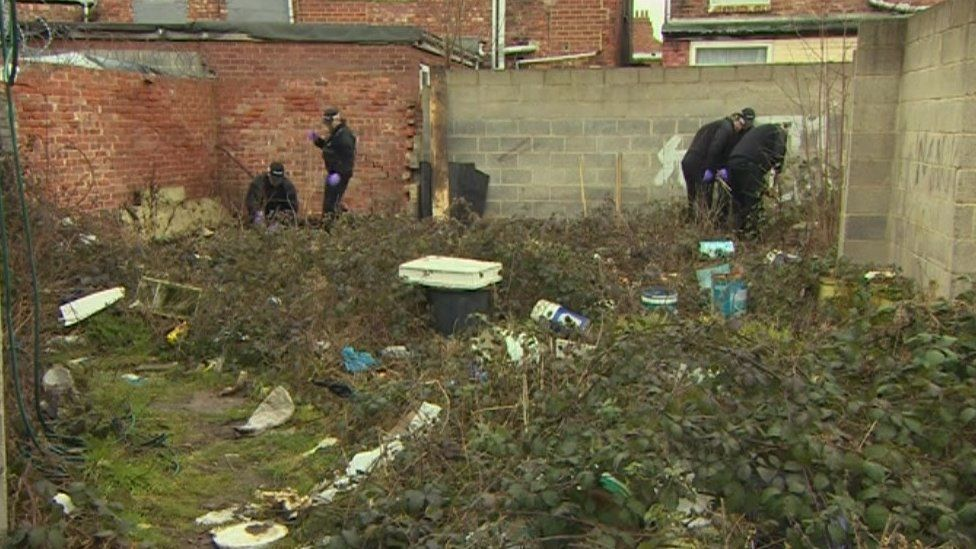 Police officers conduct a search in an area close to the last sighting of Naheed Khan