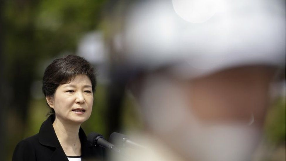 South Korea's President Park Geun-hye delivers a speech as soldiers stand guard during the country's 58th Memorial Day ceremony at the National Cemetery in Seoul in this June 6, 2013 file photo.
