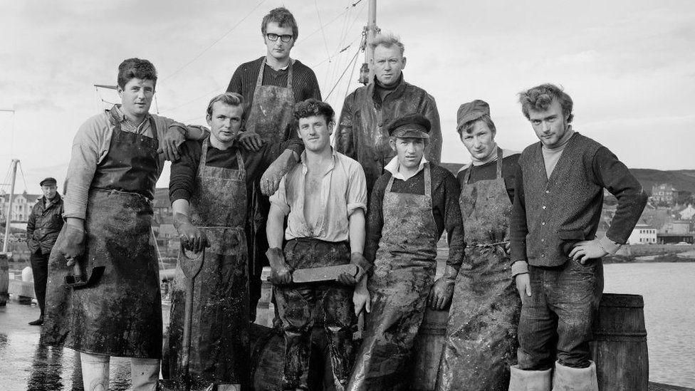 Irish men barrelling herring, Port St Mary