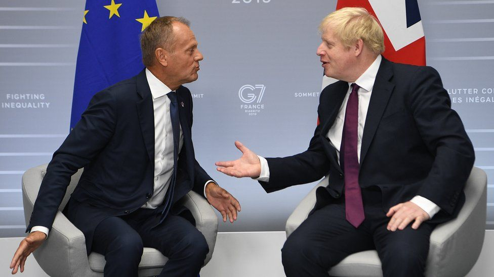 Britain's Prime Minister, Boris Johnson meets with President of the European Council, Donald Tusk at the G7 summit