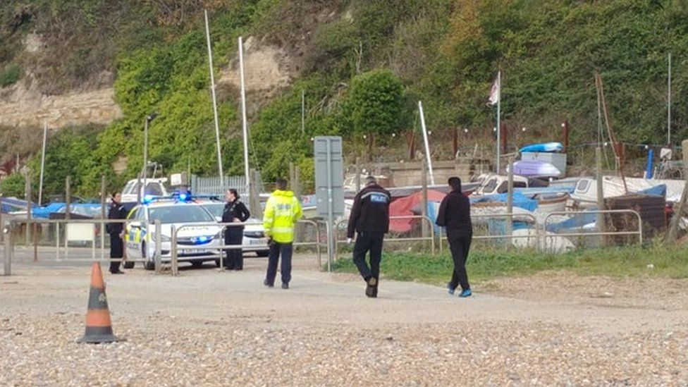 Police after beach migrant landings