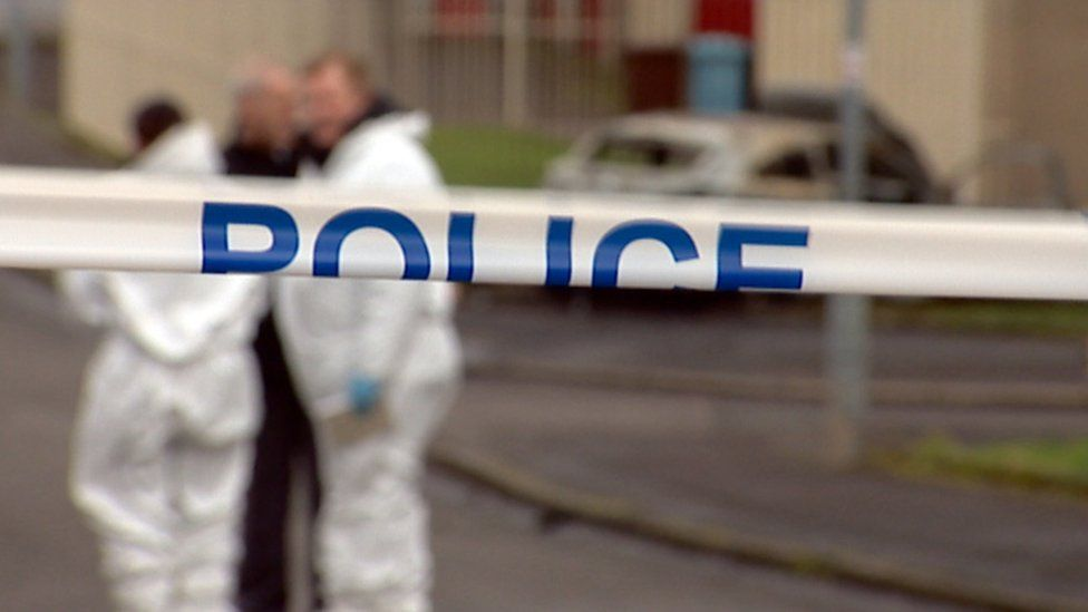 Forensic officers and police tape