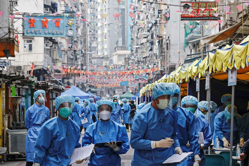 Health workers wear personal protective equipment during lockdown in the Jordan area of Hong Kong, on 23 January 2021