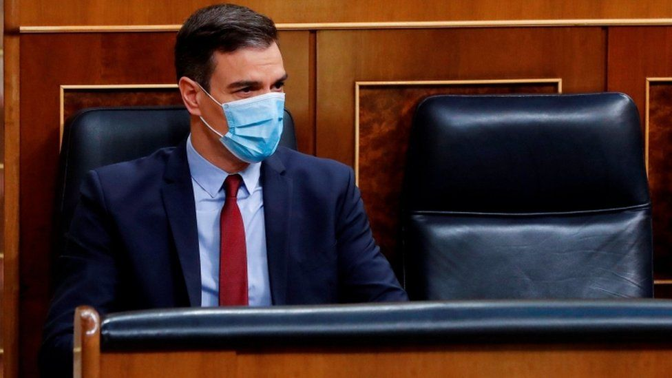 Spanish Prime Minister, Pedro Sanchez wears a face mask during a parliamentary plenary session at the Lower Chamber of Spanish Parliament