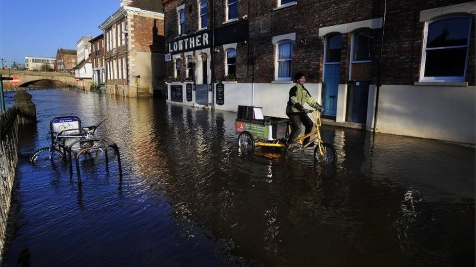 The River Ouse in York continues to rise flooding riverside properties in the City centre following heavy rainfalls across parts of the UK.