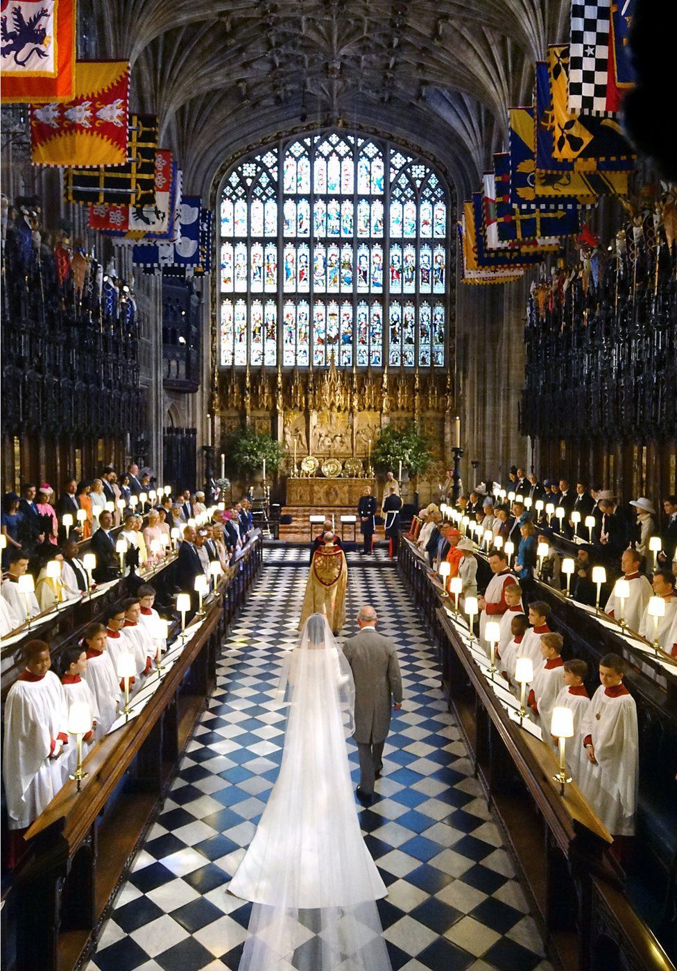 Prince of Wales walking Meghan Markle up the aisle of St George's Chapel at Windsor Castle