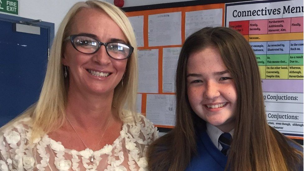 Lily Dowling whose life was saved with an adrenaline pen, with her mum Sara