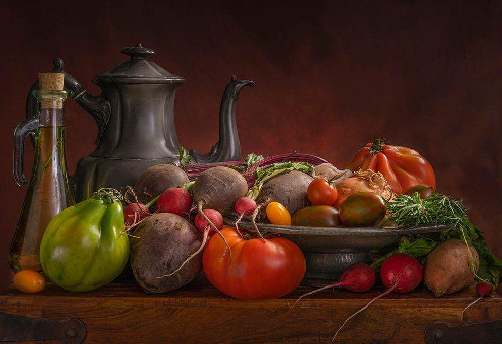 Vegetables and a metal tea pot