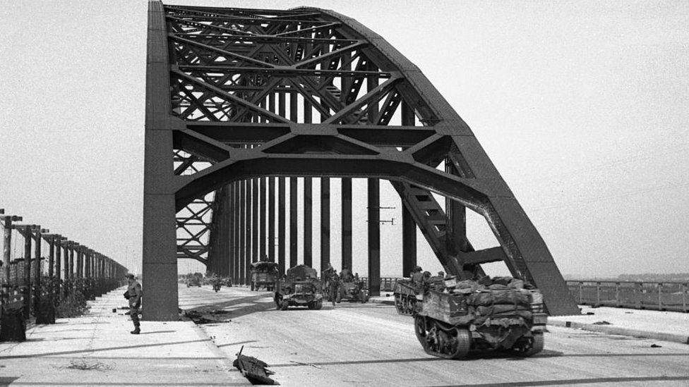 Carriers and lorries crossing the bridge at Nijmegen, 21 September 1944