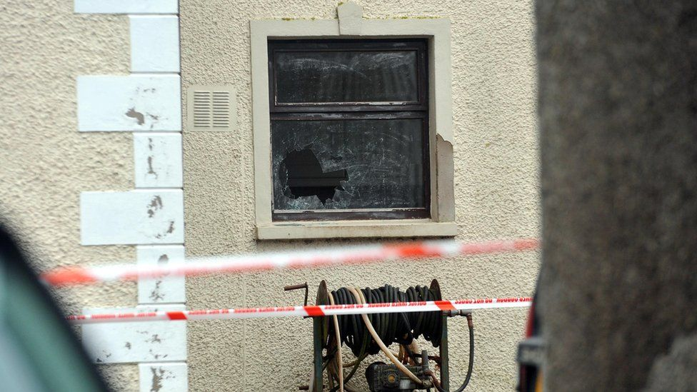 A broken window at the house in which David Murphy was shot dead