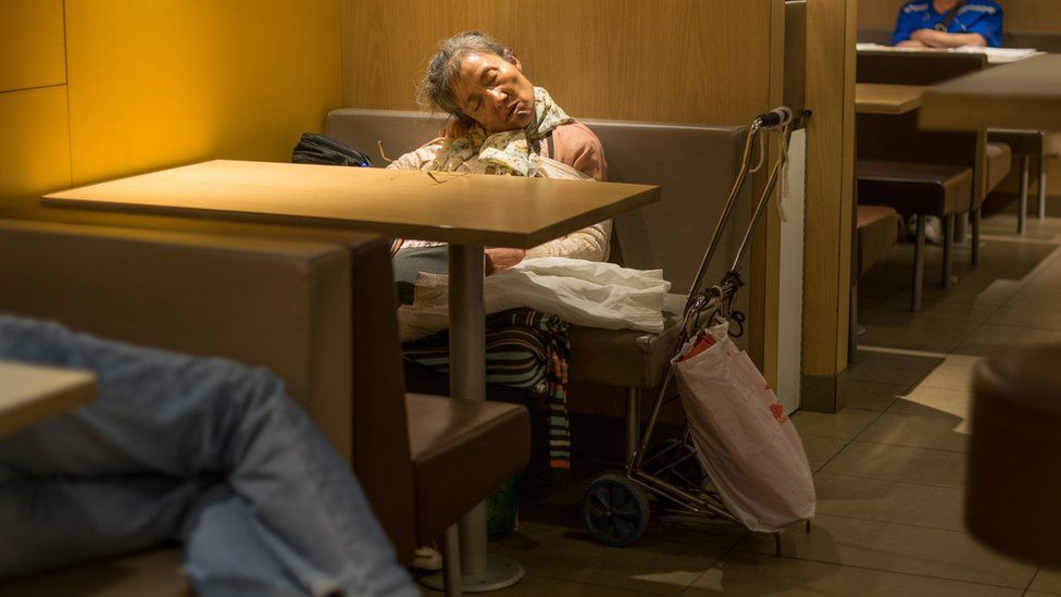 Old lady asleep in McDonald's