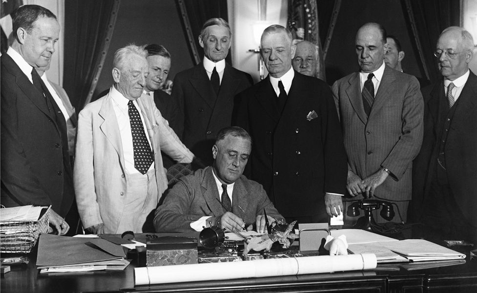 Franklin Roosevelt signs the Glass-Steagall banking reform act on 16 June, 1933.