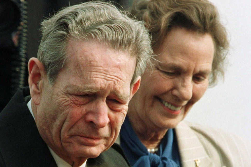 Romania's exiled King Michael, 75, tears streaming down his face, arrives together with his wife Anne in his homeland February 28, 1997