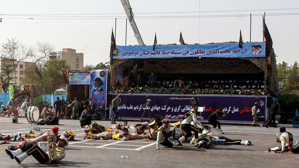 Injured soldiers lying on the ground after an attack on the military parade in Ahvaz