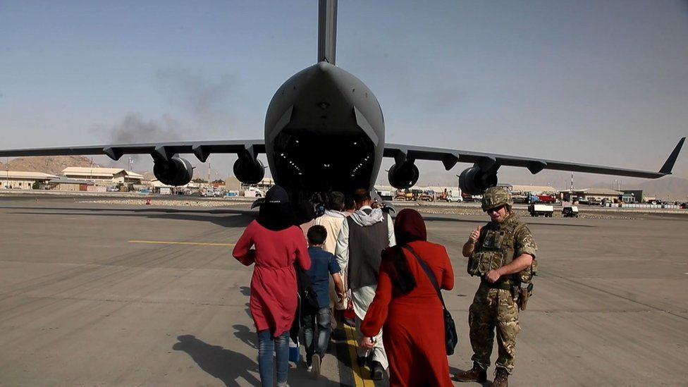 People boarding a British military plane in Kabul