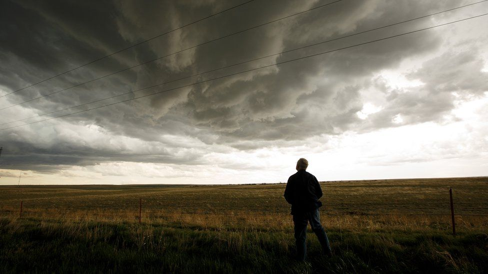 Tim Marshall monitors a supercell thunderstorm during a tornado research mission, May 8, 2017
