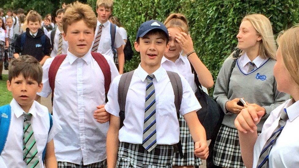 Boys at Exeter academy wear skirts in uniform protest - BBC News