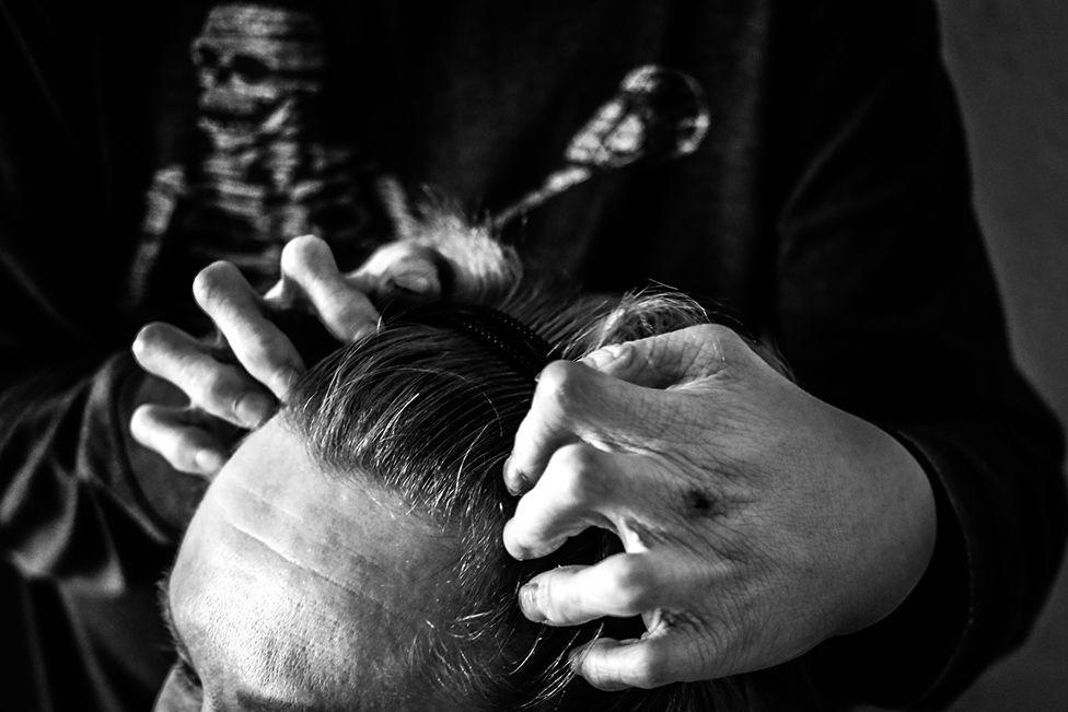 Lyosha doing head massage