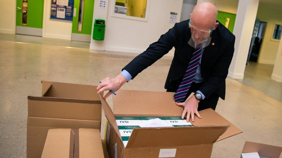 John Murphy, chief executive of Oasis Community Learning, unboxes Covid-19 testing kits at Oasis Academy Coulsdon in Coulsdon, south London