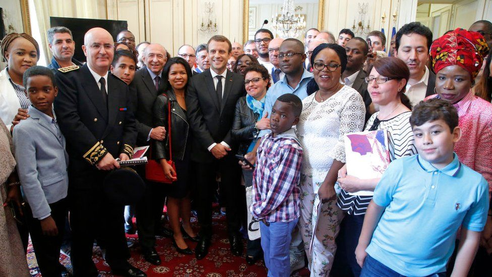 Macron standing with new citizens after the ceremony in Orleans