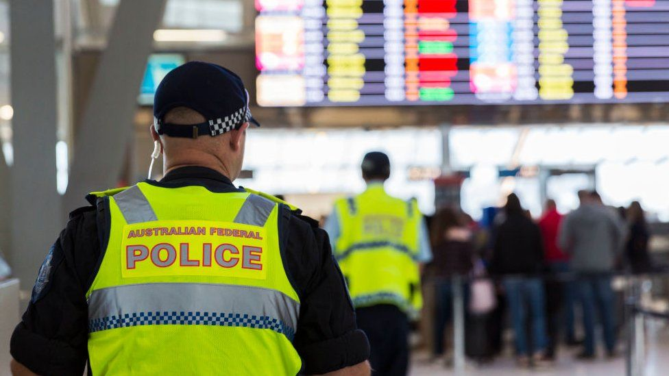 A police officer in an airport