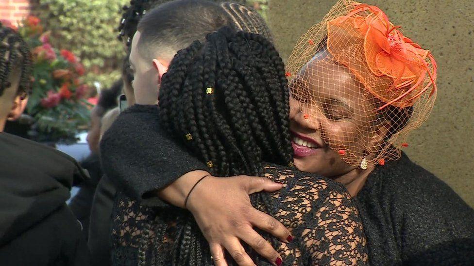 Jaden's mother hugging a funeral guest