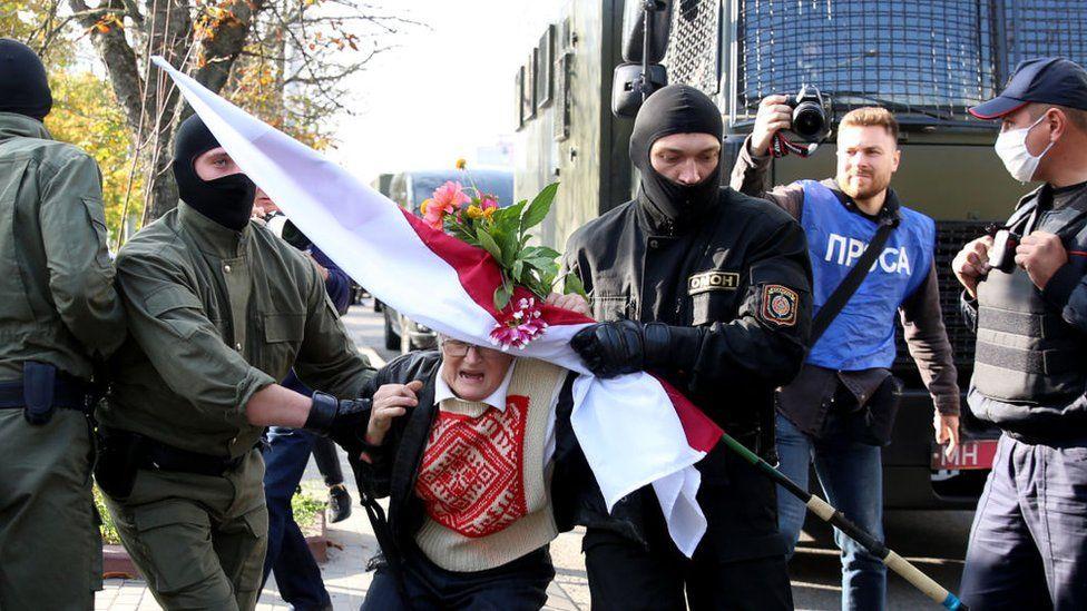 Law enforcement officers detain an opposition activist Nina Baginskaya