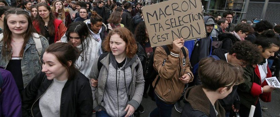 A student holds a banner during a protest against a proposed reform of the Baccalaureat system in March 2018