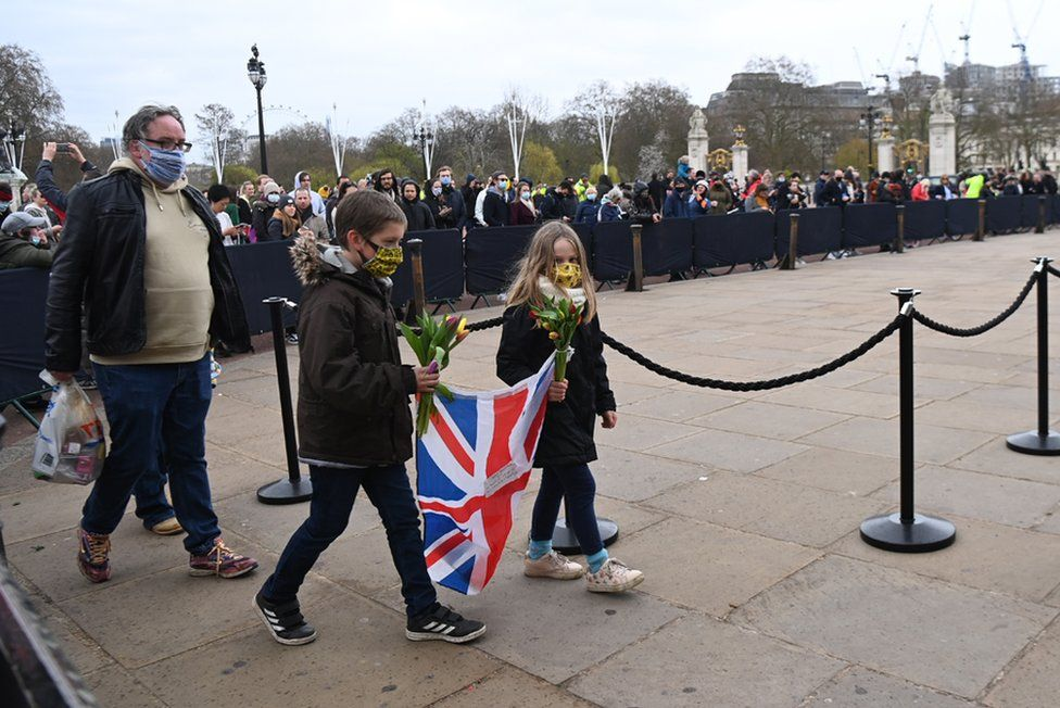People gather outside Buckingham Palace a day after the passing of Britain's Prince Philip, Duke of Edinburgh, in London, Britain, 10 April 2021.