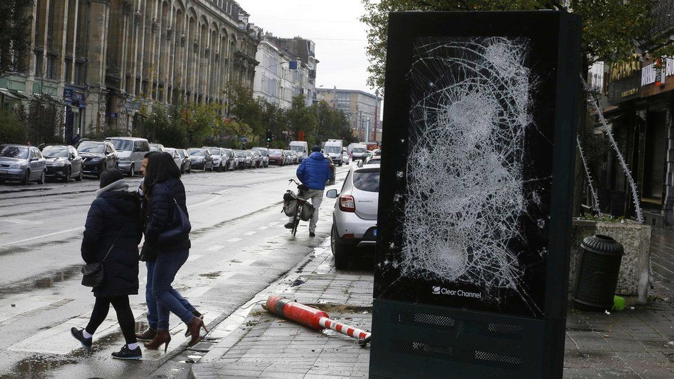 glass front of street ad smashed