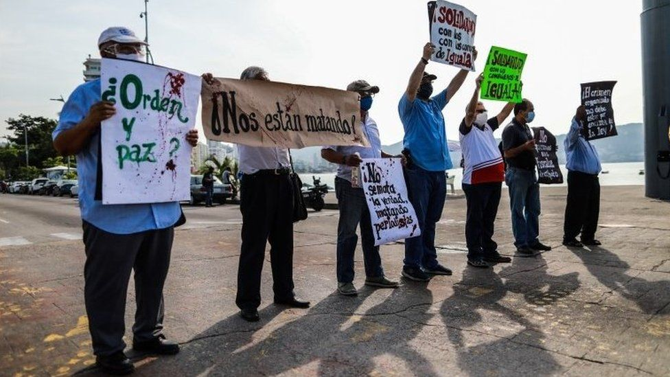 Mexican journalists hold placards during a protest demanding protection after colleagues were threatened by organized crime, in Acapulco, Mexico, 16 October 2020
