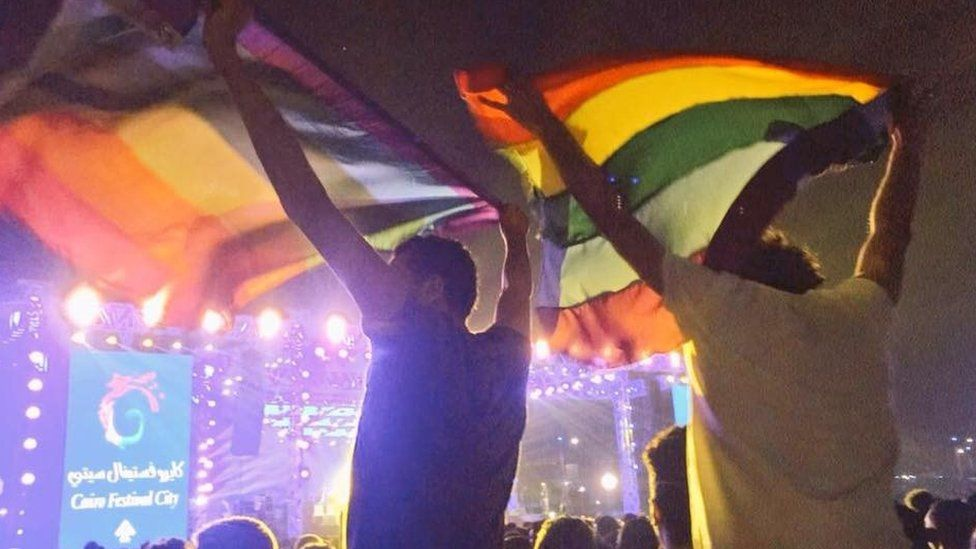 Image posted on social media purportedly showing two people holding rainbow flags at a Mashrou' Leila concert in Cairo on 22 September 2017