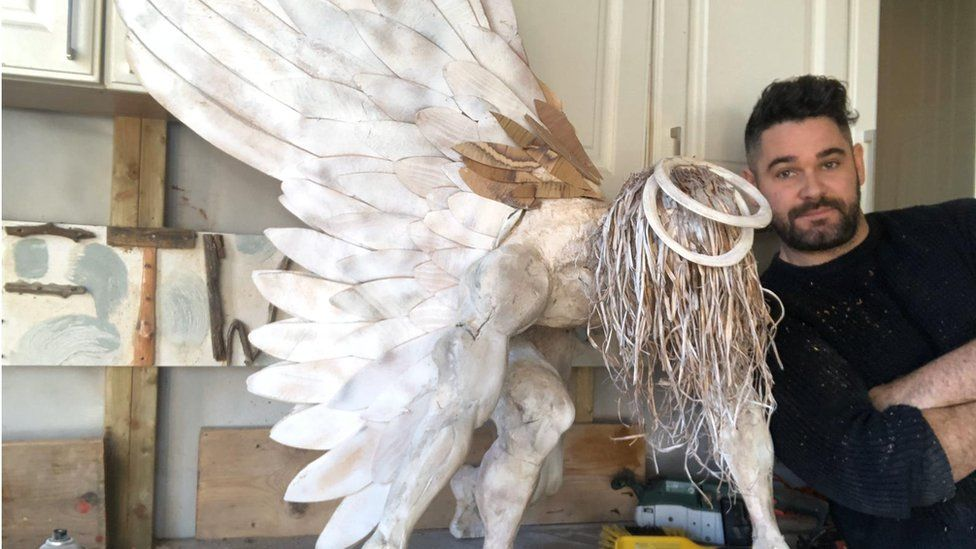 Brendan Rawlings with his angel statue.