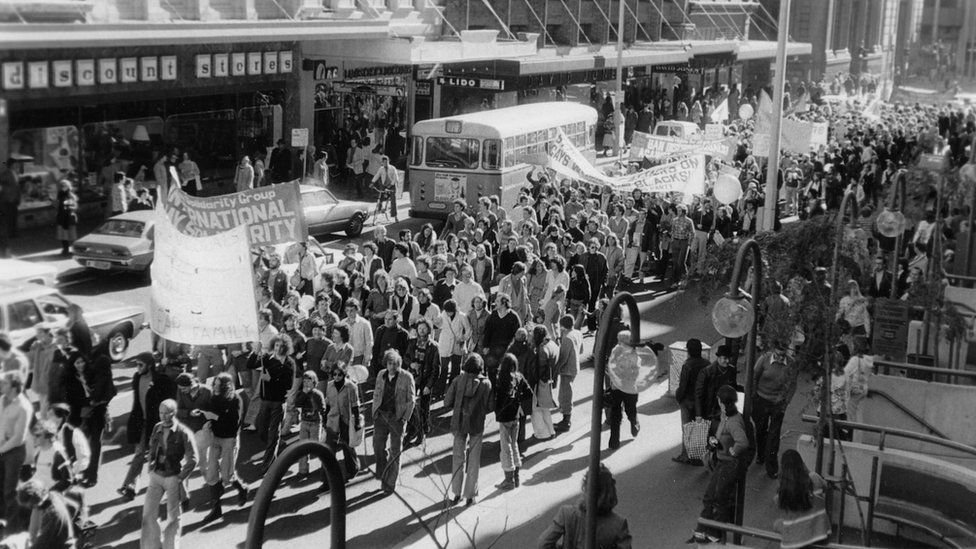 Marchers walk down a street during the 1978 Mardi Gras and Gay Solidarity Group protests in Sydney