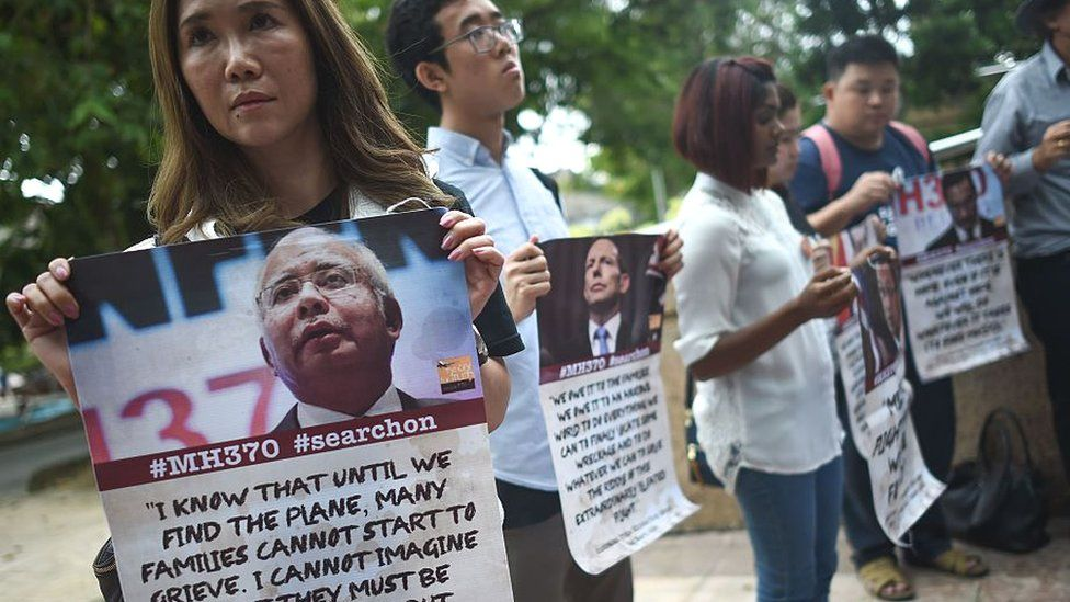 Victims' relatives and their supporters protest against the suspension of the search