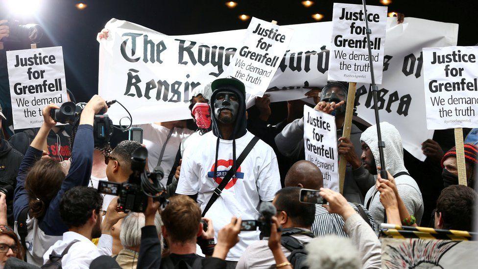A group of demonstrators gathered outside Kensington Town Hall