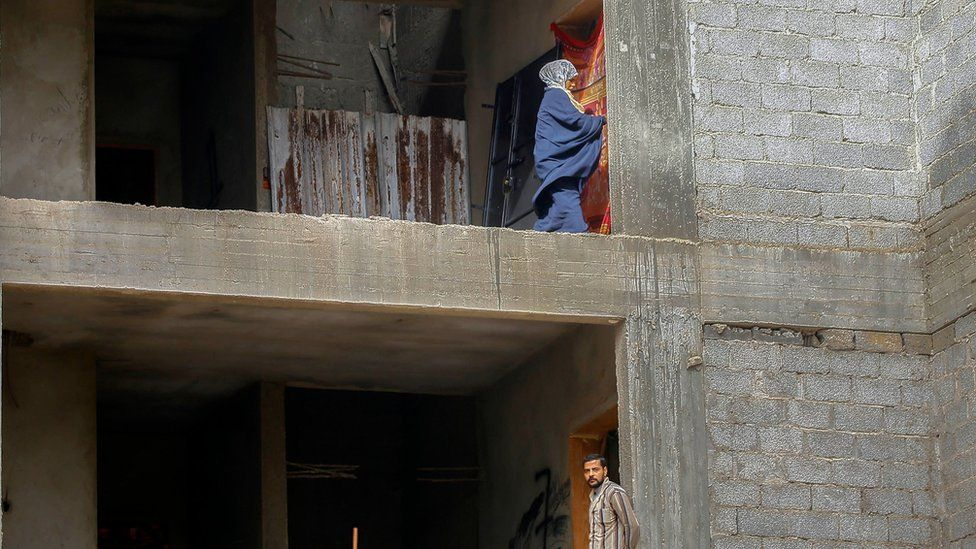 Displaced Libyans are pictured in an unfinished building in the Libyan capital Tripoli on December 18, 2019.