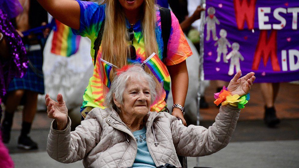 Pensioner taking part in Pride
