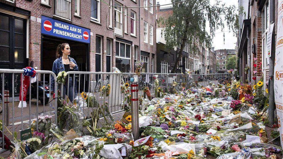 Flowers mark spot where d Vries was shot, central Amsterdam, 12 Jul 21